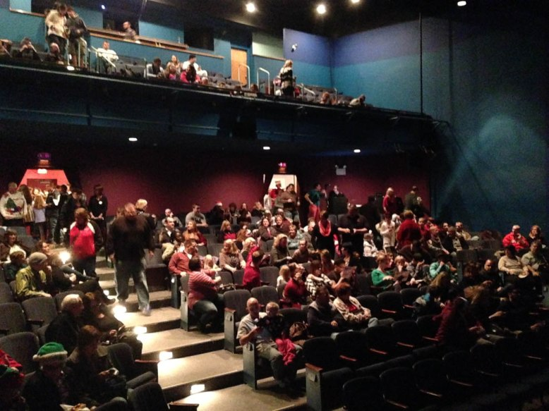 The sell-out crowd files in to see The Sandbox Rock and Roll Orchestra's annual Christmas concert.